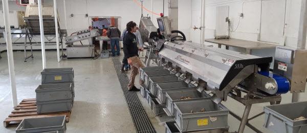 Men using machine inside a warehouse